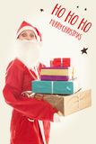 Santa Girl holding a lots of presents, Text Ho Ho Ho Merry Chris Royalty Free Stock Image