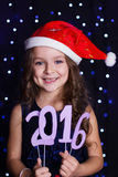 Santa girl is holding 2016 paper figures,christmas Royalty Free Stock Photo