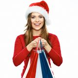 Santa girl holding shopping bag. christmass portrait of young w Stock Photos