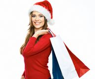 Santa girl holding shopping bag. christmass portrait of young w Stock Photo