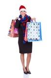 Santa-girl holding shopping bags Royalty Free Stock Image