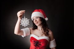 Santa girl holding snowflake stock photography