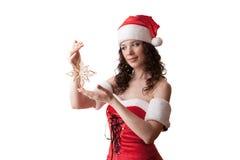 Santa girl holding snowflake Royalty Free Stock Photography