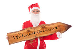 Santa Girl holding a wooden board with german word, isolated on Stock Photos