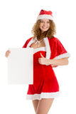 Santa girl holds blank paper with thumb up Stock Photos