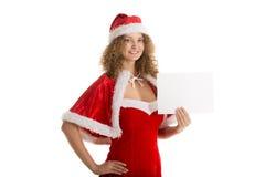 Santa girl holds small horizontal blank paper Royalty Free Stock Photography