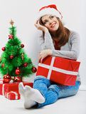 Santa girl isolated portrait with christmas gift, cristmas tree Stock Images