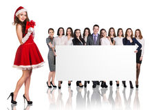 Santa girl and large group of business people royalty free stock image