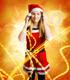 Santa girl listening to abstract christmas music Royalty Free Stock Image