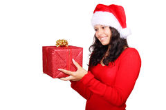 Santa girl looking at christmas gift. Isolated on white background Stock Photo