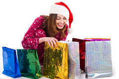 Santa girl looking into the shopping bags Royalty Free Stock Image