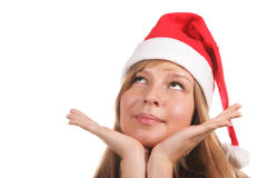 Santa girl looking up. Isolated over white background Stock Photo