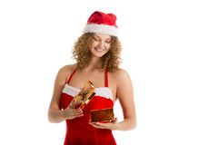 Santa girl looks into a gift box Stock Image