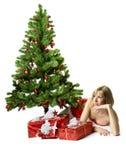 Santa girl lying under the tree Stock Image