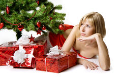 Santa girl lying under the tree Stock Image