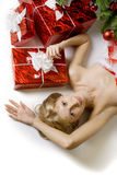 Santa girl lying under the tree Stock Photography