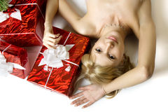 Santa girl lying under the tree Stock Photo