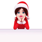 Santa girl is observing sign Stock Images