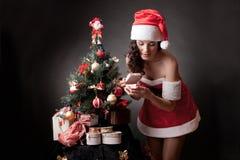 Santa girl open the gift. stock photo