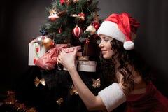 Santa girl open the gift. Stock Photos