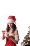 Santa girl open the gift. Royalty Free Stock Image