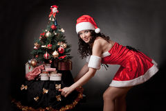 Santa girl open pull the Christmas tree. Stock Image