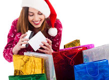 Santa girl opening the gift box. On a white background Stock Photography