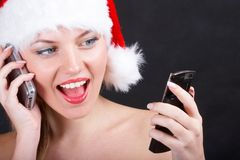Santa girl with phone Stock Photo