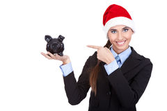 Santa girl with piggy bank Stock Image