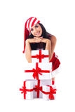 Santa girl on a pile of gifts. Santa girl is sitting on its hands on a pile of gifts. Holidays Stock Image