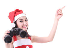 Santa girl point product after search and find Royalty Free Stock Photo