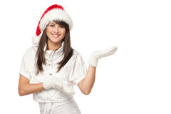 Santa girl pointing at copy space Stock Images