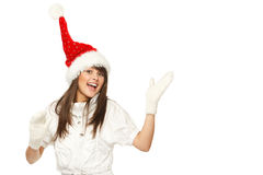 Santa girl pointing at copy space Stock Photography