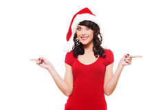 Santa girl pointing at empty copyspace Royalty Free Stock Photo