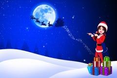 Santa girl is pointing towards iceland Royalty Free Stock Photo
