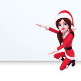 Santa girl is pointing towards white sign Stock Photography
