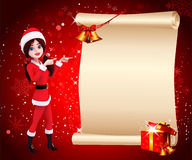 Santa girl pointing towardssign and red background Stock Images