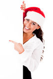 Santa girl pointing the white board Stock Photography