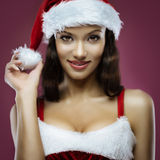 Santa girl. Portrait of cute young cheerful santa girl Stock Images