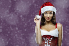 Santa girl. Portrait of cute young cheerful santa girl. Lot of copy space in left Stock Photo