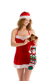 Santa girl prepares a gift Royalty Free Stock Photo