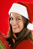 Santa Girl with present. Portrait of a smiling Santa Girl with present Stock Photos