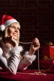 Santa girl with present Stock Photography