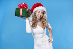Santa girl with a present gift for New Year Stock Image