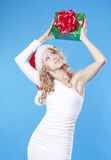 Santa girl with a present gift for New Year Stock Images