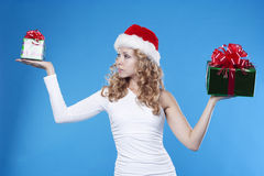 Santa girl with a present gift for New Year Royalty Free Stock Images