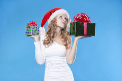 Santa girl with a present gift for New Year Royalty Free Stock Photos