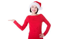 Santa Girl presenting your product Royalty Free Stock Image