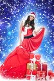 Santa girl ,presents,  blue abstract background Royalty Free Stock Photos