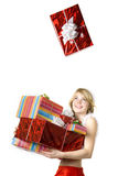 Santa girl with presents on white background Royalty Free Stock Images